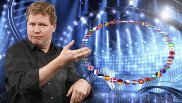 Gebärdendolmetscher Stefan Goldschmidt vor der virtuellen Bühne des ESC. © NDR, Eurovision