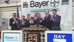 Vertreter von Bayer an der New Yorker Wall Street zum Börsengang 2002.