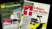 Jeweils eine Zeitschrift der Motorwelt und eine von Stiftungwarentest zum Thema E-Bike.
