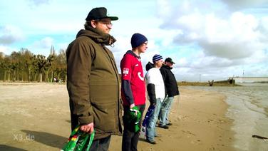 Fans am Strand