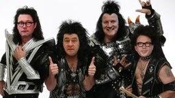Eine Fotomontage zwischen Politikern der CSU und der Band Kiss.