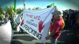 Demonstranten die gegen das Fracking sind.
