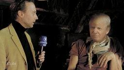 """Der Reporter und """"Donald Trump"""" im Interview."""