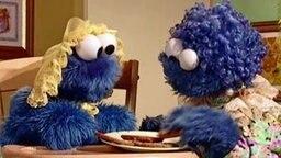Das Krümelmonster isst Kekse.