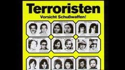 """Ein Plakat mit der Überschrift """"Terroristen, Vorsicht Schusswaffe!"""""""