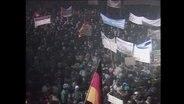 Menschenmenge einer Montagsdemonstration in Leipzig (Archivbild).