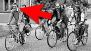 Bild von Radfahrern und einem roten Pfeil.