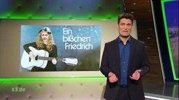 """Christian Ehring beim Stand Up Comedy zu """"Ein bisschen Friedrich""""."""
