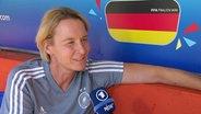 Die Bundestrainerin Voss-Tecklenburg im Interview.
