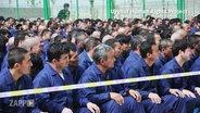 Inhaftierete Uiguren im Umerziehungslager in China.