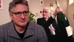 Johannes Schlüter und Sky Dumont mit Magnumflasche in der Hand