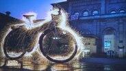 Fahrrad mit Lichtkonturen