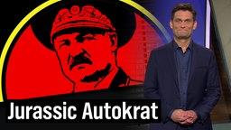 Ehring und im Hintergrund Diktator Alexander Lukaschenko.