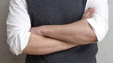 Verschränkte Arme © Fotolia.com Fotograf: Daniel Moc