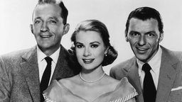 "Bing Crosby (l), Grace Kelly, und Frank Sinatra (r) im Film ""High Society"" (""Die oberen Zehntausend""). © Picture-Alliance / dpa"