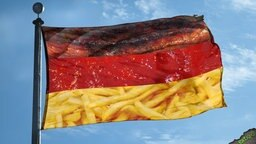 Deutschlandfahne mit Bratwurst, Ketchup und Pommes.