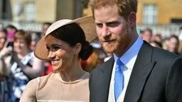 Prinz Harry und Meghan besuchen am 22. Mai eine Gartenparty im Buckingham Palace. © Picture-Alliance / Photoshot