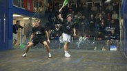 Squashspieler in Aktion