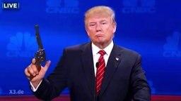 Donald Trump hält eine Waffe.