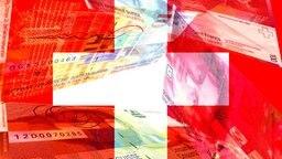 Schweizer Franken und die Schweizer Flagge © picture alliance/APA/picturedesk.com