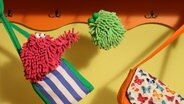 Folge 19. Pantoffelzirkus: Wisch und Mop am Taschentrapez © NDR Foto: Screenshot