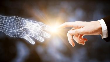 Roboterhand berührt Menschenhand © Fotolia Fotograf: peshkova