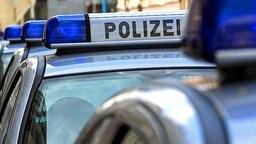 Blaulicht auf Polizeiwagen © dpa/Picture-Alliance
