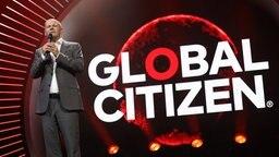 Hamburgs Erster Bürgermeister Olaf Scholz (SPD) spricht am 06.07.2017 in Hamburg auf dem ersten Global Citizen Festival-Konzert. © dpa Bildfunk Fotograf: Georg Wendt