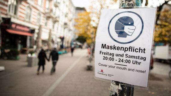 Un signe qu'un masque est requis à Hambourg.  © photo alliance / Christian Charisius / dpa Photo: Christian Charisius