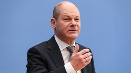 Olaf Scholz auf einer Pressekonferenz in Berlin © picture alliance/ZUMA Press