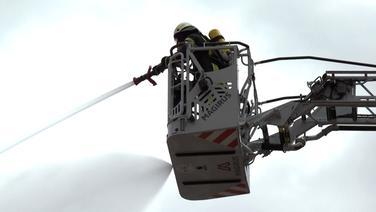 Von einer Drehleiter aus löschen Einsatzkräfte der Feuerwehr einen Brand. | TeleNewsNetwork