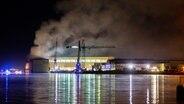 Smoke rises above the Lürssen shipyard in Bremen-Vegesack. © dpa-Bildfunk Photographer: Mohssen Assanimoghaddam