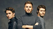 Take That mit (v.li.) Mark Owen, Gary Barlow und Howard Donald © Universal Music