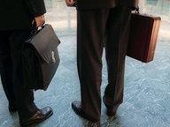 Männer mit Aktentaschen © Picture-Alliance/dpa