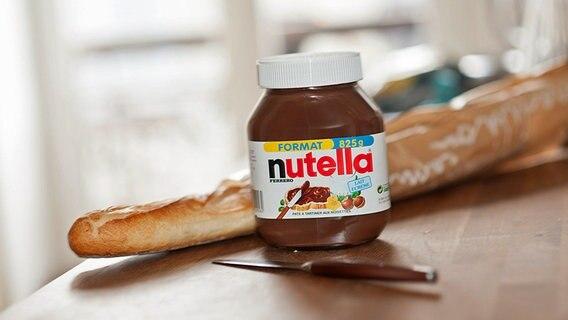 Frühstücksbrot mit Nusscreme Nutella. © dpa picture-alliance Foto: Julien MUGUET