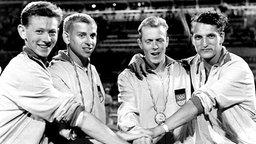 Die deutsche 4x100-m-Staffel: Bernd Cullmann, Armin Hary, Walter Mahlendorf und Martin Lauer (v.l.) © picture-alliance / dpa