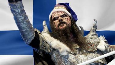 Lordi vor der Finnischen Flagge. (Bildmontage) © Fahne: Fotolia, Quelle Künstler: picture-alliance / dpa Foto: Fahne: Juergen Priewe, Fotograf Künstler: Jörg Carstensen