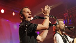 Axel Stosberg bei einem Auftritt. © Rolf Klatt Foto: Rolf Klatt