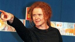 Mick Hucknall, Sänger der Band Simply Red, bei einer Preisverleihung des TV-Senders MTV im Jahr 1995. © dpa - Fotoreport