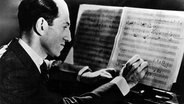George Gershwin am Flügel, 1936. © picture-alliance / akg-images